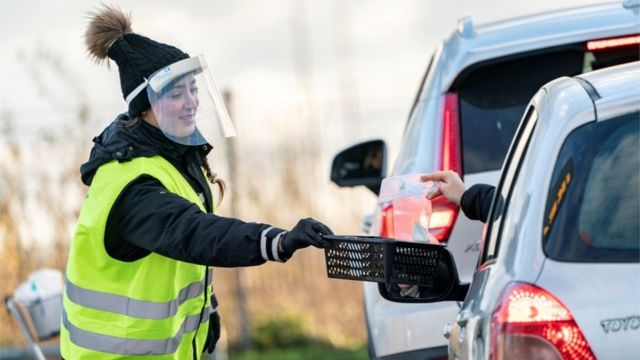 A woman collects covid-19 test samples in the Swedish city of Malmo.