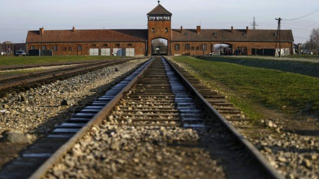 Auschwitz visitors urged not to balance on railway tracks for photos