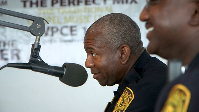 Police officers attending a call-in radio programme