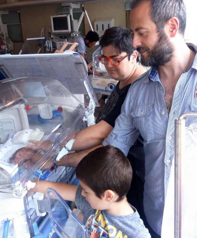 Valentina Daprile , husband Luigi, and son Leone, with Angelo Ray in the incubator
