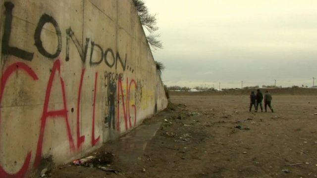 Children walk towards a Calais camp