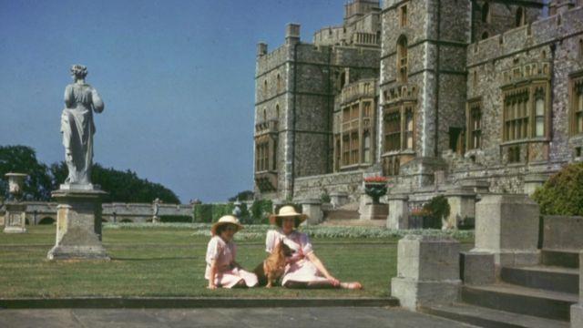 Queen Elizabeth II and Princess Margaret as children in front of Windsor Castle