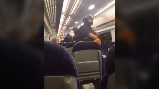 Footage of armed officers on the train at Gillingham