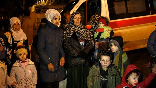 People wait to leave the besieged town of Madaya, northwest of Damascus, Syria.