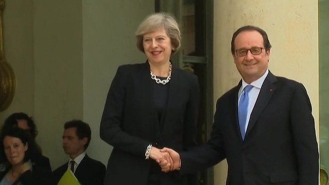 Theresa May shakes hands with Francois Hollande