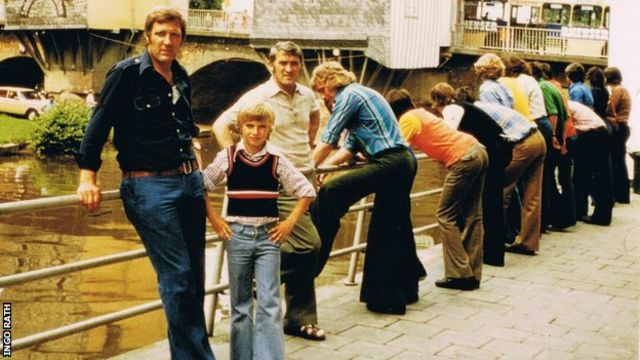A young Klopp poses for a photo with his father Norbert
