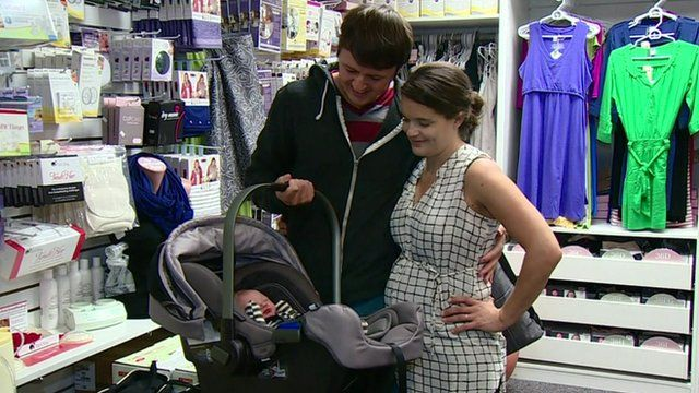 Mother, father and baby in a shop