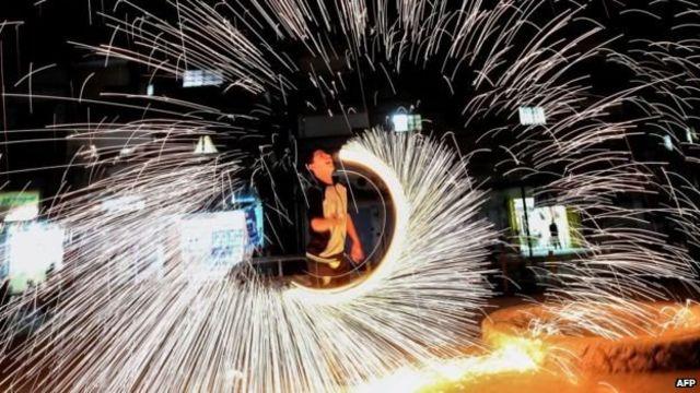 Boy enjoying fire works
