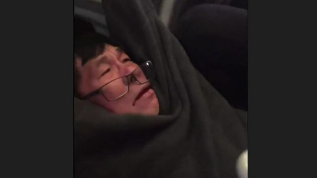 Passenger seen with glasses falling off and blood on his mouth