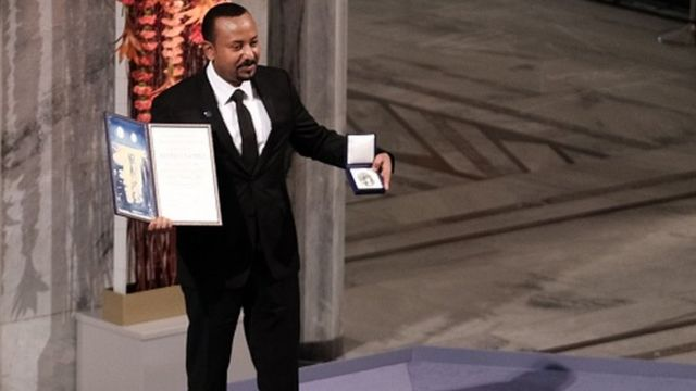 Ethiopia's Prime Minister Abiy Ahmed Ali poses after being awarded with the Nobel Peace Prize