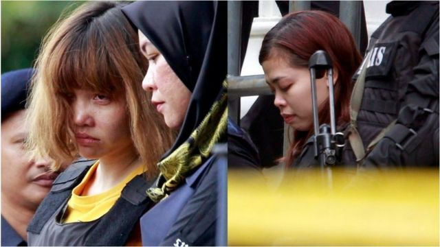 Doan Thi Huong (left) and Siti Aisyah (right) outside court in Malaysia, surrounded by armed guards. 1 March 2017.