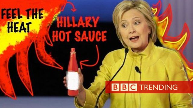 Hillary Clinton and a bottle of hot sauce