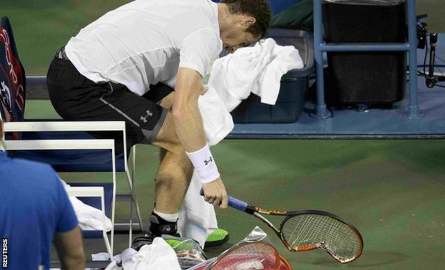 Andy Murray smashes his racquet
