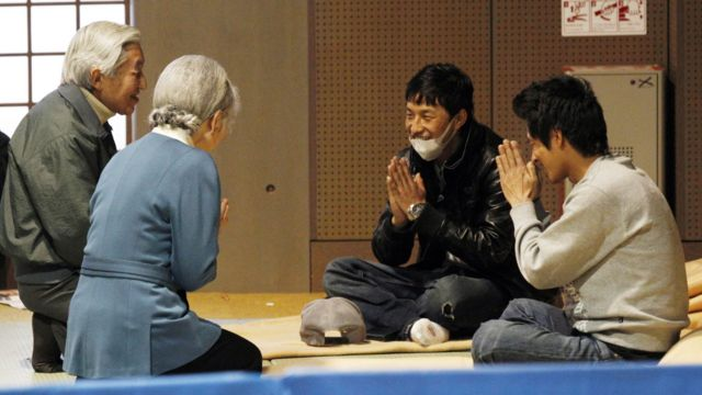 Emperor Akihito and Empress Michiko talk with evacuees from the 2011 earthquake and tsunami.