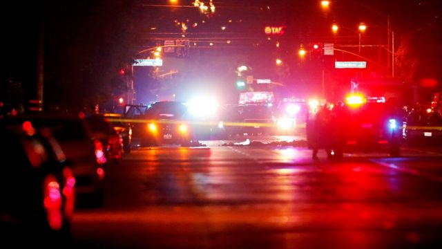 Police vehicles line the street around a vehicle in which two suspects were shot following a mass shooting in San Bernardino, California December 2, 2015