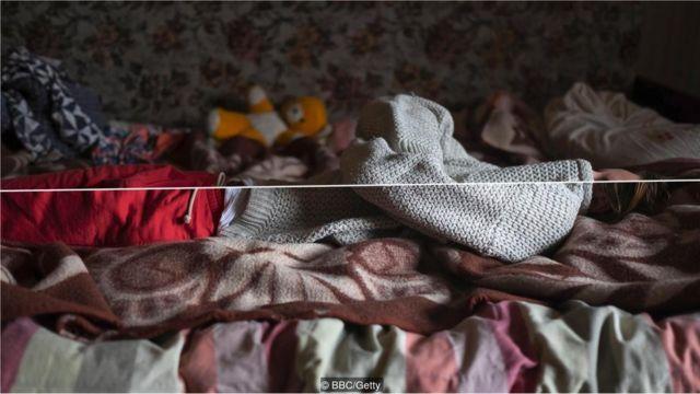 Jovem na cama