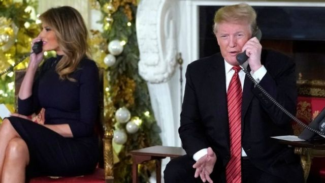 Melania Trump and Donald Trump take calls from American children in the White House, Washington. Photo: 24 December 2018