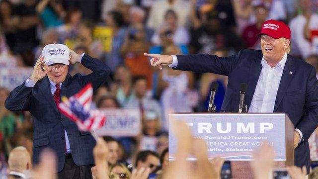 US Republican presidential candidate Donald Trump introduces Alabama Senator Jeff Sessions during a rally