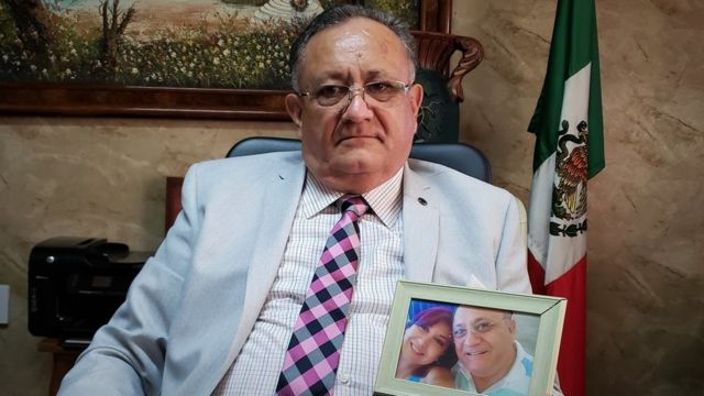 Octavio Cotero holds a photo of his missing daughter