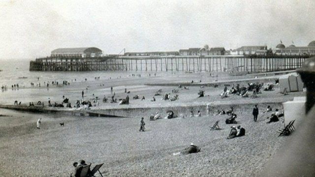 Still from montage of photos of Hastings Pier