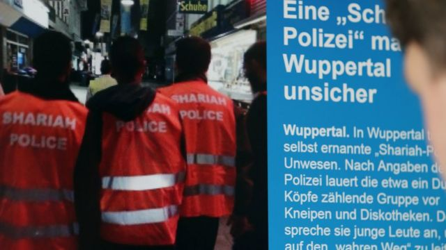 """""""Sharia police"""" featured on a web page in Germany - Sep 2014 pic"""