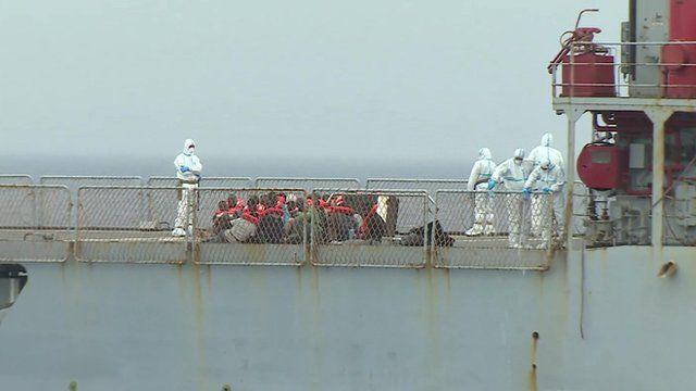 Migrants on board an Italian war ship
