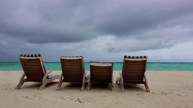Deckchairs on a beach in Male