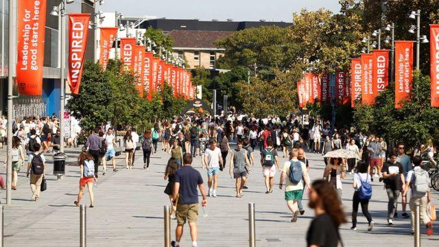 Students walk through an Australian university campus