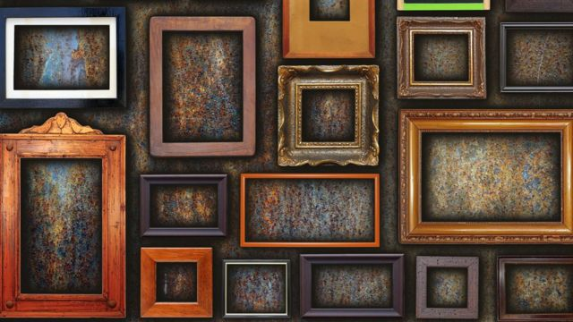 Many picture frames hanging off a wall
