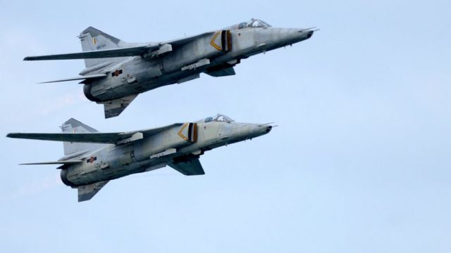 Sri Lankan Air Force MiG-27 aircraft fly in formation during a Victory Day parade in Colombo on May 19, 2012. President Mahinda Rajapakse, in an address to the nation, said he could not dismantle military camps in the embattled regions and undermine national security in a country emerging from nearly four decades of ethnic bloodshed.'The diaspora has not stopped their activities (against Sri Lanka),' Rajapakse said, referring to Tamil separatists abroad. 'It is no secret that LTTE (Liberation Tigers of Tamil Eelam) leaders are freely operating abroad.' AFP PHOTO/Ishara S. KODIKARA (Photo credit should read Ishara S.KODIKARA/AFP/GettyImages)