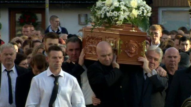 Mourners carry the coffin of Christopher Meli