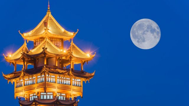 Moon over tower in Chengdu, China