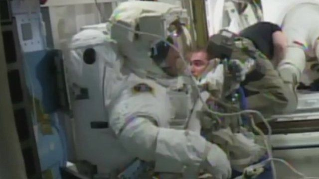 Tim Peake in his spacesuit ready to go in to the airlock