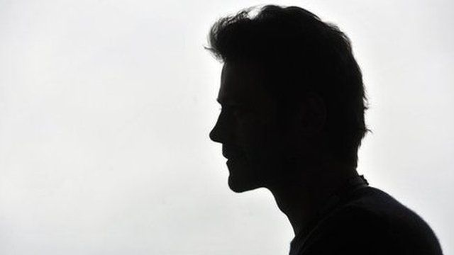 An anonymous man in silhouette