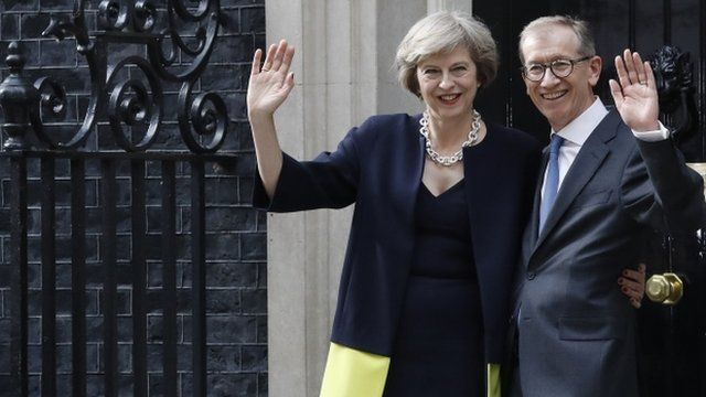 Theresa May with husband outside Downing Street