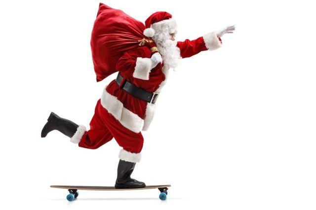 Santa Claus riding a longboard