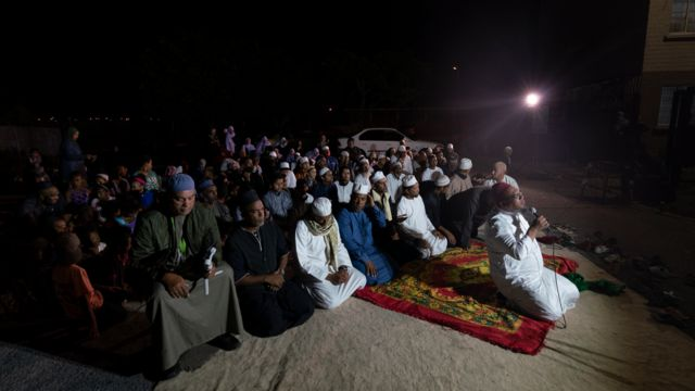 People kneeling during a dhikr session in Manenberg, Cape Town - South Africa