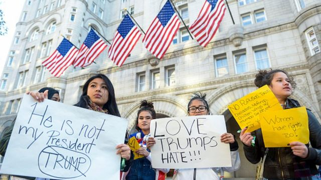 Protesters outside the Trump International Hotel in Washington DC