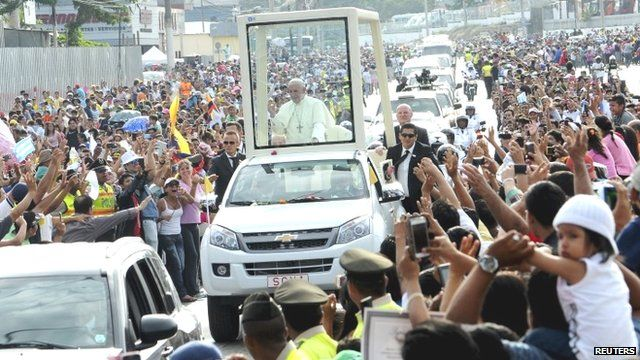 Pope Francis waves to the crowds in Guayaquil, Ecuador