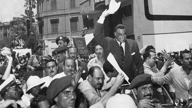 A crowd greets Nassar after the Egyptian President's announcement of the nationalization of the Suez Canal.