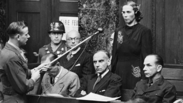 Inge Viermetz, the only woman defendant being tried before Tribune 1 in the RuSHA Nuremberg Trials, stands up to plead 'not guilty' to being responsible for the Lebensborn in Nazi Germany, October 23rd 1947. (Photo by Keystone/Hulton Archive/Getty Images)