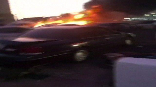 vehicle on fire outside mosque in Medina, Saudi Arabia