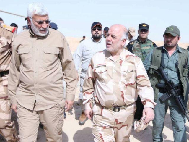 حيدر العبادي وابو مهدي المهندي خلال زيارة العيادي الى الموصل