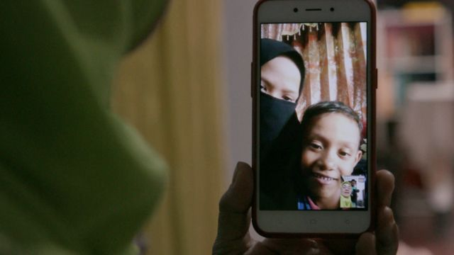 Fikri video calling his grandmother