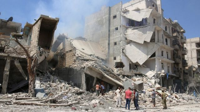 Men inspect a damaged site after double airstrikes on the rebel held Bab al-Nairab neighbourhood of Aleppo on 27 August