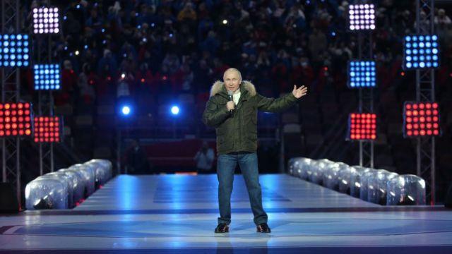 Vladimir Putin on a stage