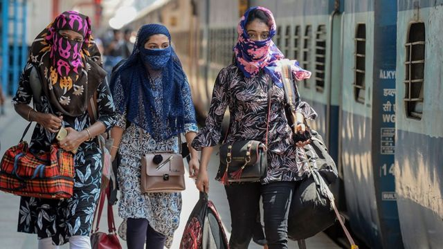 Women in India with faces covered