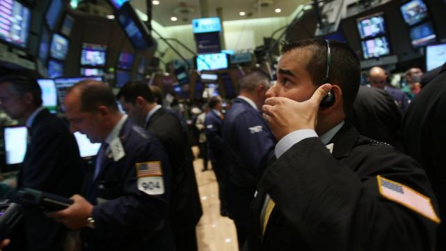 A trader looks anxious on the floor of the New York Stock Exchange on the day Lehman Brothers filed for bankruptcy