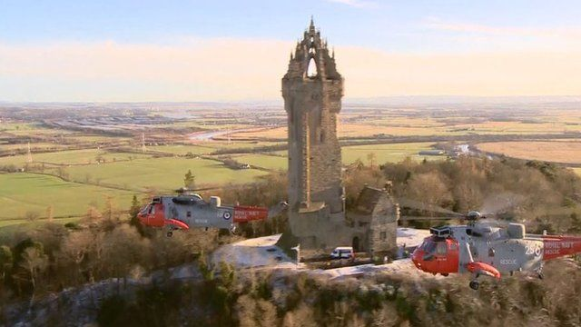 Sea King helicopters fly by the Wallace Monument