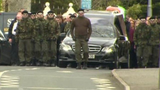 Men in paramilitary-style uniforms attended Michael Barr's funeral